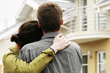 Young couple consider home